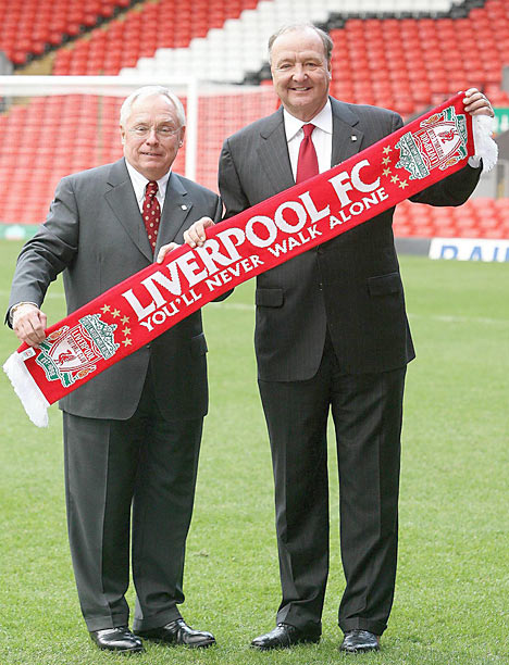 Tom Hicks (right) and  to his  business partner George Gillett Jr , owners  of the  Premiership  soccer club  Liverpool FC. The  co-owners  are  now  said  to be  feeling  the  brunt  of the  anger  from  Liverpool's  fans  as they're  said  to  be  considering  selling  the  team's best  player , Fernando Torres.  Much  to  the  chagrin  of the  team's   coach, Rafael  Benitez.  The coach  has let it  be  known  that  should  the  team  sell  Torres.  Then  he  too  will   quit  the  club  immediately.   Much  of this problem  has  been  created  by  the  financial  maneuvering  of the  owners  as   they've  laden  the  club  with  an  excessive  amount  of   debt.     picture  appears  courtesy  of  dailymail.co.uk/ Andrew Fogarty  ..................