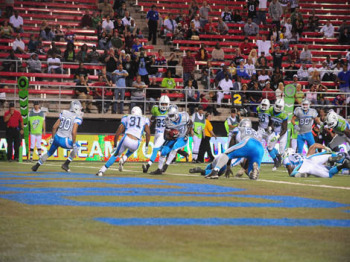 A  UFL game   between  the  Las  Vegas Locomotives  and  the  California  Redwoods  .   The  game was  won  by the  Locos  over  the Redwoods  30-17  .