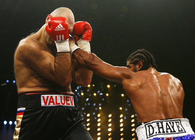 With the  distinct  height  and  weight advantage   Valuev (left)  still  gets  caught  by  the  challenger  , David  Haye  ,  in  their  WBA  heavyweight title  bout.      picture appears courtesy of  afp photo dpp/ getty images/  Timm Schamberger  .................