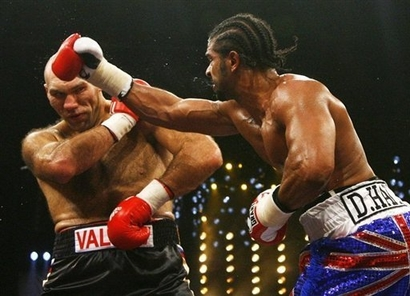 Valuev (left) looks to defend  himself against  the  challenger  ,  Haye , in their WBA heavyweight  title   fight held  in  Nurumberg  Germany  on the  7th  November  2009.       picture appears  courtesy of  afp/getty images/ Shaun  Curry ........