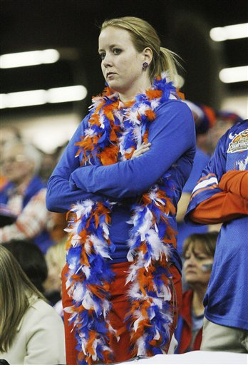 A disheartened  Florida fan can't hide her  disappointment at the end of a 32-13 loss to Alabama in the NCAA college football SEC championship game at the Georgia Dome in Atlanta Saturday, Dec. 5, 2009. picture appears courtesy of AP/photo/ John Amis ......