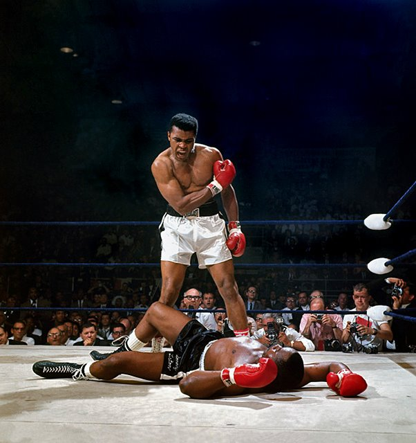 A prostrate Sonny Liston  lies on  his back  having  been  just  knocked to the  canvas  by  Muhammad Ali in their heavyweight title  fight.   These two  famed  fighters would  meet twice professionally  over their fabled  careers.  Each time  Ali  , the  younger  fighter  would  end  being  a  decisive winner.   picture appears  courtesy  afp/reuters  .............