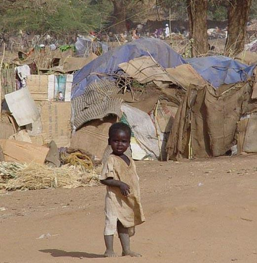 A  Sudanese  child  stands  in the  midst  of  a Darfur refugee  camp  for  misplaced  Sudanese  refugees.     picture  appears   courtesy  of  AFP/ Reuters/    Alexander  Richardson  .....