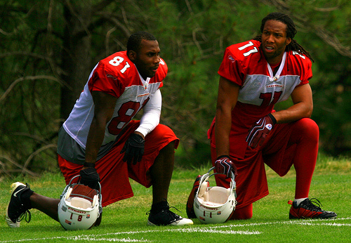 Anquan Boldin (left) seen here with  teammate, Larry  Fitzgerald at the  Arizona Cardinals'  practice facility in  Tempe, Arizona.  The  two players  are  part  of the  'dynamic duo'  that has  been  often  described as  the  best  receiving  tandem in  the entire  NFL.  It certainly makes  life a great deal  easier  for  Cardinals' quarterback  Kurt Warner having  to  throw  to  either  of the  two  players.      picture  appears  courtesy of ap/photo/  Rob  Pearcey   ...................