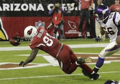 Arizona Cardinals' Anquan Boldin (81) dives for a touchdown as Minnesota Vikings' E.J. Henderson runs in late to defend in the second quarter during an NFL football game Sunday, Dec. 6, 2009, in Glendale, Ariz. picture appears courtesy  of ap/photo/ Ross D. Franklin .....