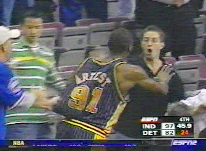Artest (91) seeks retribution  against  a  fan   whom  he  believes  thew an   open container of  alcohol  at  him  from  up in the  stand  unto the   floor   during  the  game   played  between  the  Pacers  and  Pistons  played at  the Palace  of Auburn Hills .   copyrighted  material   @  All  rights  reserved  .............................