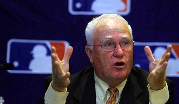 MLB President and Chief Operating Officer (COO) Donald  DuPuy  , seen here addressing members  of the  convened  press .    picture  appears courtesy  of   getty  images/ Paul  Rosenbaum  .................