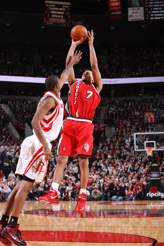 Portland ,Or -December 5th : Brandon Roy (7) of the Portland Trail Blazers takes a shot over Trevor Ariza (1) of the Houston Rockets during a game on December 5, 2009 at the Rose Garden Arena in Portland, Oregon. picture  appears courtesy of NBAE/ Getty Images/ Sam Forencich  ............