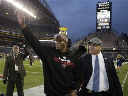 Tampa Bay Buccaneers coach Raheem Morris waves to fans as he walks off the field after the Buccaneers beat the Seattle Seahawks 24-7 in an NFL football game.  picture  appears  courtesy  of  AP/photo/  Ted  S Warren  ....................