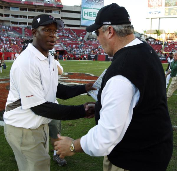 New York Jets head coach Rex Ryan, right, shakes hands with Tampa Bay buccaneers head coach Raheem Morris, left, after the Jets defeated the Buccaneers 26-3 during an NFL football game Sunday, Dec. 13, 2009, in Tampa, Fla.