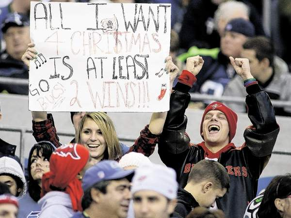 Bucs'  fans  in the  hope  of an  early  Christmas  wish  and gift  in the  team's  game  against the  Seattle Seahawks  on   Sunday  afternoon  played  at  QWest  Field  in Seattle , Washington,.    picture appears courtesy of  ap/photo/ Ted S.  Warren  ............