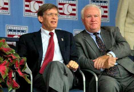 Baseball commissioner , Bud Selig , seated  left  and  MLB Chief  Executive  Officer  Bob  DuPuy.   Selig is  due to step   down   from  his  role  as baseball  commissioner   in 2012.  A  position  which  he has  held  first on  an interim  basis and  then  permanently  from 1993 to  the present day.  picture  appears  courtesy  of  ap/photo/ Roger  Scott  ................
