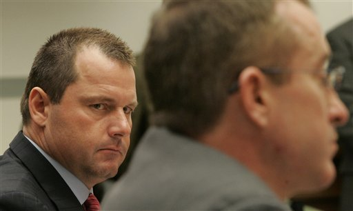 This Feb. 13, 2008 file photo shows former New York Yankees baseball pitcher Roger Clemens, left, listening to the testimony of his former personal trainer Brian McNamee, right, on Capitol Hill in Washington during the House Oversight and Government Reform Committee hearing on drug use in baseball. Clemens broke his silence Tuesday, again denying that former personal trainer Brian McNamee injected him with performance-enhancing drugs in his first public comments in more than a year. picture appears courtesy of ap/photo/ Susan Walsh ......