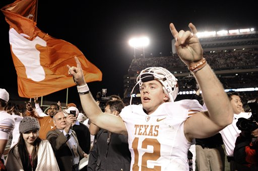 Texas quarterback Colt McCoy (12) celebrates after their NCAA college football game against Texas A&M Thursday, Nov. 26, 2009 in College Station, Texas. Texas beat Texas A&M 49-39. picture appears courtesy of ap/photo/ Dave Einsel .....