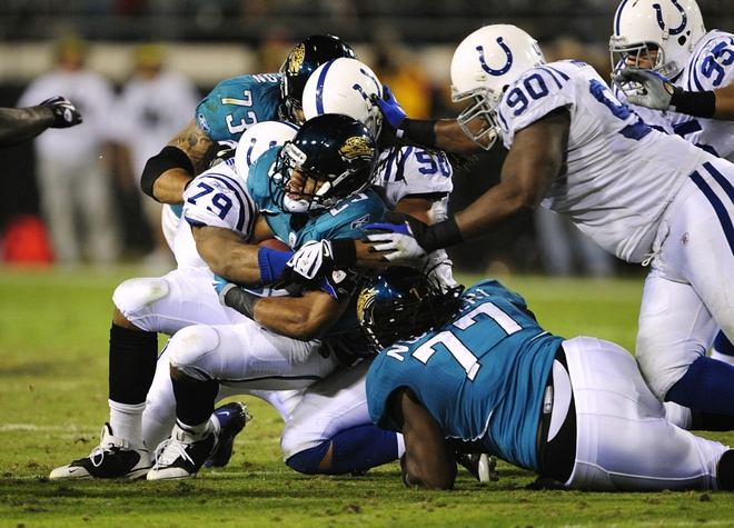 Jacksonville , Fl - December 17th 2009. Maurice Jones-Drew (#32) of the Jacksonville Jaguars is stopped by the Indianapolis Colts at Jacksonville Municipal Stadium in Jacksonville, Florida.  picture appears  courtesy of Getty Images/  Sam Greenwood  .........