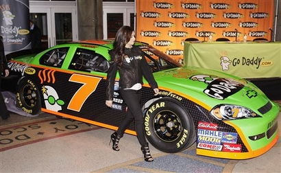 CORRECTS TO DEBUT TO ARCA RACE, NOT NATIONWIDE RACE   IndyCar driver Danica Patrick checks out her new GoDaddy.com No. 7 JR Motorsports stock car during an event announcing her intention to make her stock car racing debut in an ARCA race Tuesday, Dec. 8, 2009, in Phoenix. Patrick has signed with JR Motorsports team, owned by Dale Earnhardt Jr. and Rick Hendrick, and intends to start in her first in an ARCA Series race on Feb. 6 at Daytona International Speedway. picture  appears courtesy of  ap/photo/ Ross D.  Franklin .....