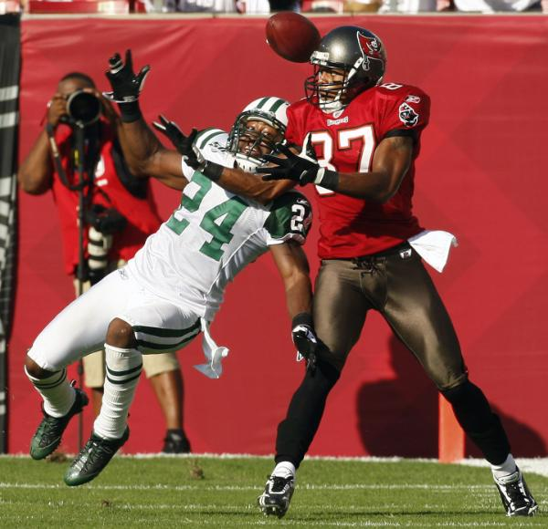 New York Jets cornerback Darrelle Revis (24) knocks the ball from Tampa Bay Buccaneers wide receiver Brian Clark (87) during the third quarter of an NFL football game Sunday, Dec. 13, 2009, in Tampa, Fla