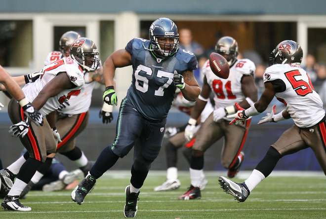 Linebacker Geno Hayes (#54) of the Tampa Bay Buccaneers makes an interception against the Seattle Seahawks on December 20, 2009 at Qwest Field in Seattle, Washington.   picture appears  courtesy  of  Getty Images/  Otto  Greule Jr ................