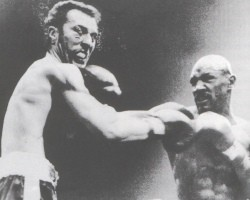Hagler lands  a  shot to Minter's   jaw in the  second  round  of their  middleweight  title   fight  .
