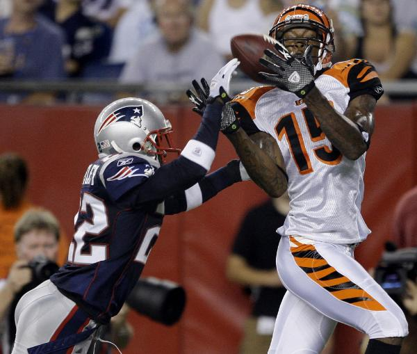 Cincinnati Bengals' wide receiver Chris Henry (15), hauls in a touchdown against New England Patriots cornerback Terrence Wheatley, left, during their preseason NFL football game in Foxborough, Mass., Thursday, Aug. 20, 2009.  picture appears  courtesy of  ap/photo/ Charles  Krupa  ........