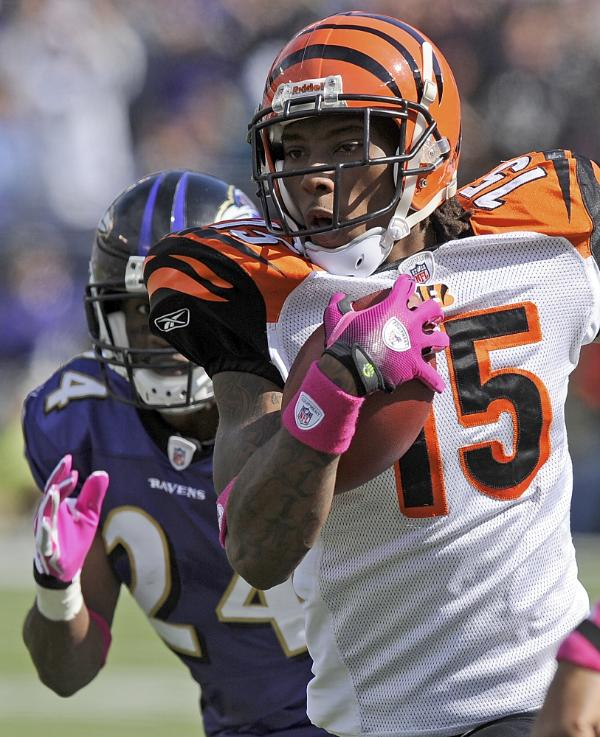 Cincinnati Bengals wide receiver Chris Henry carries the ball during the NFL football game against the Baltimore Ravens, Sunday, Oct. 11, 2009 in Baltimore. (AP Photo/Nick Wass)