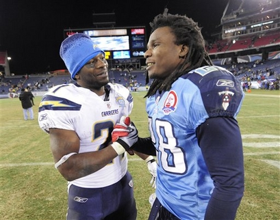 San Diego Chargers running back LaDainian Tomlinson, left, shakes hands with Tennessee Titans running back Chris Johnson after the Chargers defeated the Titans 42-17 in an NFL football game on Friday, Dec. 25, 2009, in Nashville, Tenn.  picture appears courtesy of  ap/photo/ John  Russell  .........