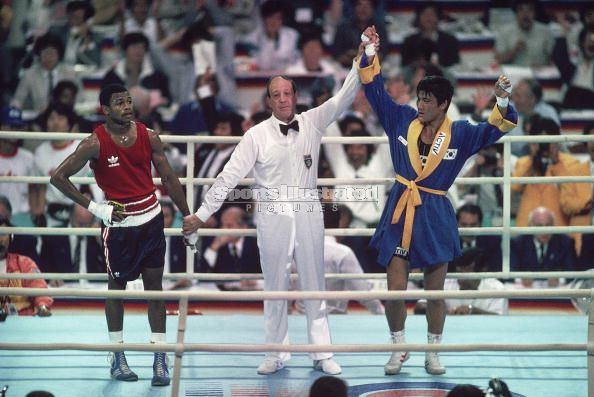 Jones (left) and  the eventual  winner of the  1988  Olympic light middleweight  boxing  title  Park Si-Hun (Korea), whose hand  is   raised  by  Italian  referee  Aldo  Leoni, after the  decision  was announced.   Fans  in attendance   would   boo  the  decision  and   an  appeal  would   be  lodged  by  the  US  boxing  delegation  as   well as  by the  US Olympic  Committee (USOC). It  would  prove to  be  fruitless  as  the  decision would  stand.  Jones'  career  from  thereon in  has been   filled   with the  highest   of the  highs  and  lowest  of the  lows.  Come  full  circle  and    what  was  thought  to  be  merely  a  tune  up   fight  against   lightly  regarded   Australian   ,  Danny  Green  ,  would  prove  to be  another  horrific  chapter  in  Jones' career  .  A  career  which  has   now  sunk  to the  lowest  point   of  his   entire  professional   boxing  career.  His   shocking   first  round  knockout  loss  to   Green,  in  Australia   ,  essentially   derails   the  proposed  fight  that  he'd   hoped to   obtain  in   meeting  Bernard  Hopkins   in  a big  money  bout  for  early   2010.         picture  appears  courtesy  of   Getty Images/ Sports Illustrated /  John  Iaccono  ..........................