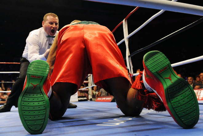 Four-division world champion Roy Jones Jnr of the US is counted out by the referee (L) after being hit by Australian titleholder Danny Green in their IBO cruiserweight World Title bout in Sydney on December 2, 2009. Green took just 122 seconds to TKO Jones in the first round.  AFP/Getty Images/ Torsten  Blackwood ...........  copyrighted material @ all rights  reserved