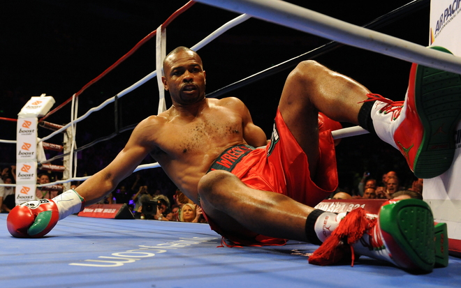 Four-division world champion Roy Jones Jnr of the US lies on the mat after being hit by Australian titleholder Danny Green during the IBO cruiserweight World Title bout in Sydney on December 2, 2009. Green took just 122 seconds to TKO Jones in the first round.   picture appears courtesy of  AFP/Getty Images/Torsten  Blackwood  .........