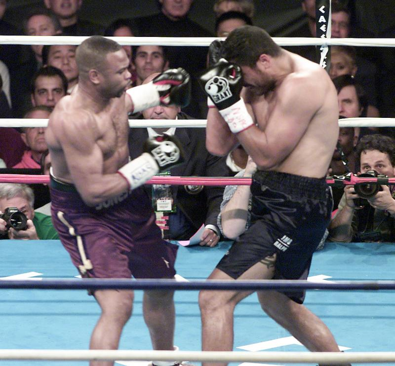 Roy Jones Jr (left), vs John  Ruiz  ,  for  Ruiz's  WBA  heavyweight   title   belt  at  the  time.  Jones  would   win the  bout   with a  unanimous  12  round  decision  over  the champion.    picture  appears  courtesy of  Getty Images/   Charles   Donovan  ..............