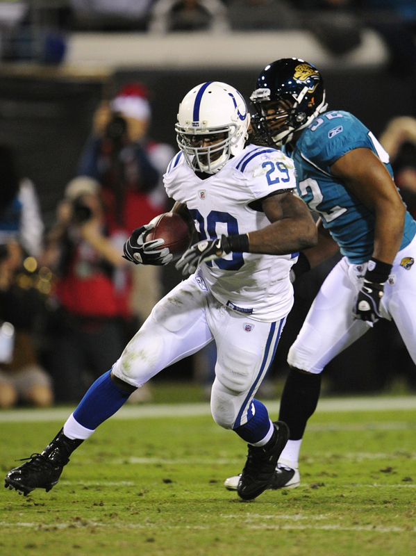 Joseph Addai (#29) of the Indianapolis Colts runs the ball against the Jacksonville Jaguars at Jacksonville Municipal Stadium on December 17, 2009 in Jacksonville, Florida. The Colts would go on to  defeat the  Jaguars 35-31 to keep their  unbeaten  record  in tact.  picture appears  courtesy of Getty Images/ Sam  Greenwood .......
