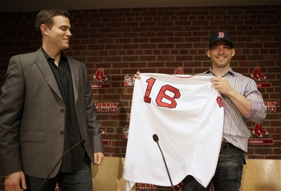 Boston Red Sox general manager Theo Epstein, left, looks on as newly signed Red Sox shortstop Marco Scutaro displays a Red Sox uniform during a news conference at Fenway Park, in Boston, Friday, Dec. 4, 2009. After cycling through seven shortstops since the middle of the 2004 season, the Red Sox announced on Friday that they have given Scutaro a two-year deal with a club option for 2012. picture appears courtesy of AP/Photo/ Steve Senne .......