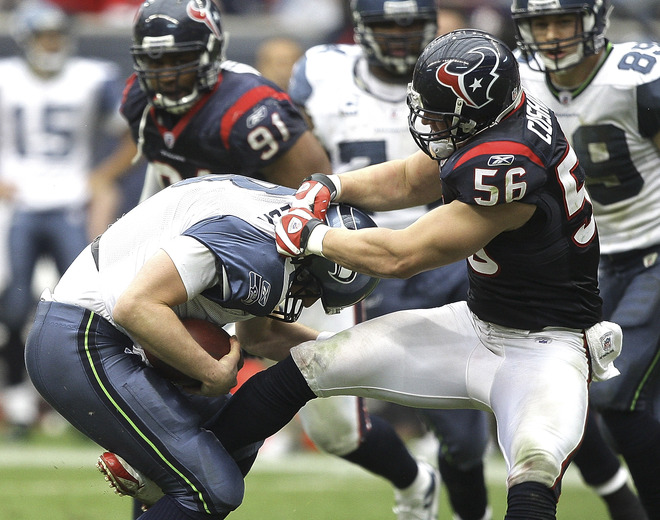 Houston , December 13th, 2009.  Quarterback Matt Hasselbeck (#8) of the Seattle Seahawks is sacked by linebacker Brian Cushing (#56) of the Houston Texans in the third quarter at Reliant Stadium on December 13, 2009 in Houston, Texas. Houston won 34-7.   picture appears  courtesy  of  Getty Images/ Bob Levey .......