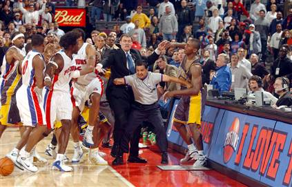 An initial scene  from what then  lead  on to the ensuing melee'  that took  place  at an  NBA game  between  the  Detroit Pistons and  the Indiana Pacers  as the Palace of  Auburn  Hills,  Auburn  Hills, Mi,.   The  fights  between  the players  and  then  with the  Pacers'  Artest  rushing  into  the stands  to  punch  a  fan led to  one  worst  scenes  of  violence  at  a  North American  sporting  event  in  recent  history.   picture  appears courtesy  of  NBAE / Getty Images/ Allen Einstein ........................