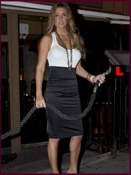 Rachel Uchitel  one  of the several women   now said to  be caught  up  in  the Woods'  sexual  intrigue and  exploits.   Uchitel  works a  nightclub  hostess  in an upscale New York City nightclub.   picture appears courtesy  of  ap/photo / Ty  Zimmerman  .........