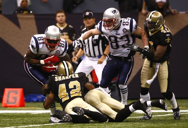 Randy Moss (81) of the New England Patriots is tackled after he made a reception in the second half by Darren Sharper (42) of the New Orleans Saints at Louisana Superdome on November 30, 2009 in New Orleans, Louisiana. picture appears courtesy of Getty Images/ Scott Halleran .........