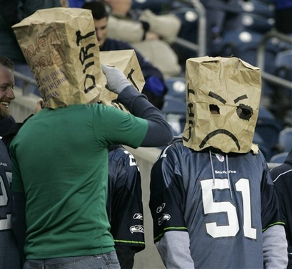 Seattle Seahawks fans wear bags over their heads to  show their disgust  at the  team's  effort in the final minutes of Seattle's 24-7 loss to the Tampa Bay Buccaneers in an NFL football game Sunday, Dec. 20, 2009, in Seattle.  picture  appears  courtesy  of  AP/photo/ John Froschauer .........