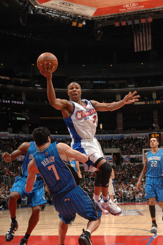 Los Angeles - December 8th 2009: Sebastian Telfair (#3) of the Los Angeles Clippers goes up for a shot against J.J. Redick #7 of the Orlando Magic at Staples Center in Los Angeles, California.  picture  appears courtesy of NBAE/ getty images/ Noah  Graham  .............