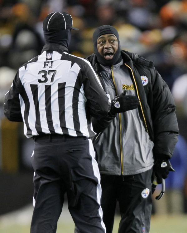 Pittsburgh Steelers coach Mike Tomlin argues with field judge Jim Howey (37) in the fourth quarter of an NFL football game against the Cleveland Browns Thursday, Dec. 10, 2009, in Cleveland. Pittsburgh lost their fifth straight, losing to the rival Browns 13-6