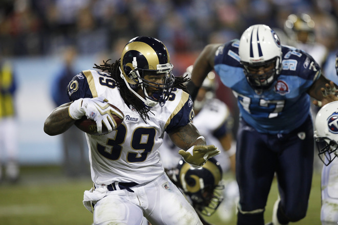 Steven Jackson (#39) of the St. Louis Rams looks for room while running with the football against the Tennessee Titans at LP Field on December 13, 2009 in Nashville, Tennessee. The Titans defeated the Rams 47-7.  picture appears  courtesy of Getty Images/ Joe Robbins  ............