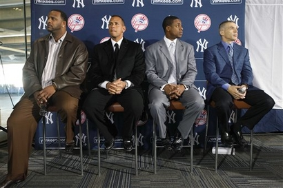 New York Yankees C.C. Sabathia, left, Alex Rodriguez, second from left, Curtis Granderson, second from right, and manager Joe Girardi attend a press conference at Yankee Stadium in New York, Thursday, Dec. 17, 2009, where Granderson was introduced as the newest Yankees player.