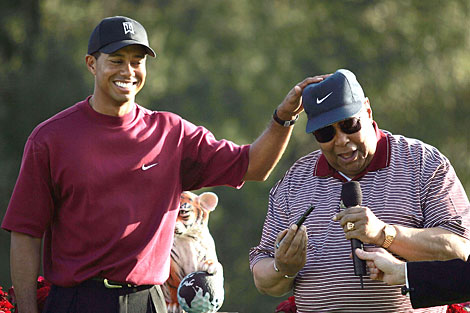 Tiger and  his  father,  Earl Woods  at  Torrey  Pines in  Southern  California.   picture  appears courtesy  of   getty  images /  Doug Benc  ....................