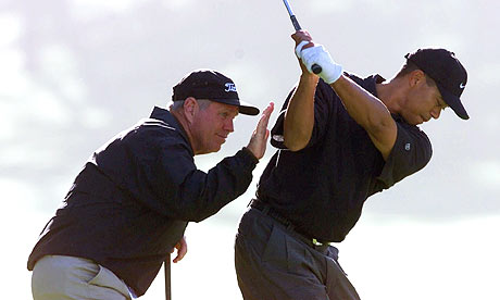 Tiger Woods is  seen here  with  his  former coach  , Butch Harmon .  The two  split  in what was  said to be  at  the  time under somewhat  acrimonious  circumstances.  Something  now which  both parties  deny.   picture  appears courtesy of  ap/photo/  Eric  Richsberg .............