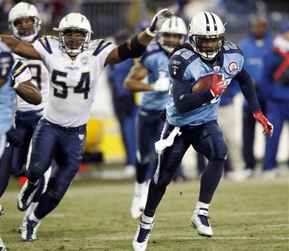 Tennessee Titans running back Chris Johnson, right, scores a touchdown on a 30-yard run ahead of San Diego Chargers linebacker Stephen Cooper (54) in the fourth quarter of an NFL football game on Friday, Dec. 25, 2009, in Nashville, Tenn. The Chargers won 42-17.  picture  appears courtesy of  ap/photo/  Wade Payne .....