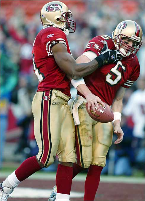 In happier times  former  San Francisco 49ers'  teammates  Jeff Garcia (5) and  Terrell  Owens .  picture appears courtesy  of Sports Illustrated  /Getty  Imagrd/  Doug Miralle .......