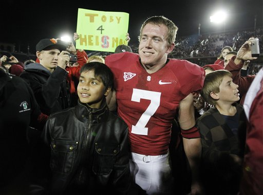 Stanford running back Toby Gerhart (7) is surrounded by fans after Stanford defeated Notre Dame 45-38 in their NCAA college football game in Stanford, Calif., Saturday, Nov. 28, 2009. picture appears  courtesy of ap/photo/ Paul Sakuma ......