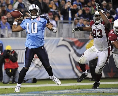 Tennessee Titans quarterback Vince Young (10) passes from his own end zone as Arizona Cardinals defensive end Calais Campbell (93) rushes him in the fourth quarter of an NFL football game Sunday, Nov. 29, 2009, in Nashville, Tenn. Young led the Titans on a 99-yard drive to score the winning touchdown in the Titans' 20-17 win. picture appears courtesy of  AP/photo/ Mark  Goodwin   ...........
