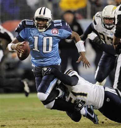 Tennessee Titans quarterback Vince Young (10) is brought down by San Diego Chargers linebacker Tim Dobbins (51) after Young scrambles for a 2-yard gain in the third quarter of an NFL football game on Friday, Dec. 25, 2009, in Nashville, Tenn.   picture appears  courtesy of ap/photo/ John  Russell  .................