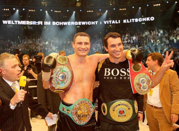 Vitali (left) and Wladimir  Klitschko   of the  Ukraine.   At  present   the  two  brothers   hold  three  of   the  four  major  recognized  heavyweight  title  belts  between  them.     picture appears  courtesy  of  theindependent.uk.co/ Ian  McGregor  ................