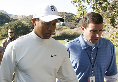 Woods  and  his  agent,  Mark  Steinberg.   Steinberg, an  employee  of  sports' agency conglomerate  IMG ,  has  the sole  responsibility of looking after Woods.  As  IMG's largest  standing  client  in  terms  of  not  only  notoriety but  also the  marketing millions  that the  golfer   generates  as  an  endorser  for  numerous  Fortune  500  companies. Steinberg  now  has  to   quietly  try and  create  presence  whereby   he can  negate and  perhaps  curtail the  firestorm  that  has  entrapped the  golfer.  Woods  hasn't made it any  easier  by  refusing  to  make  a  public  statement.    picture  appears courtesy  of  ap/photo /  ...................